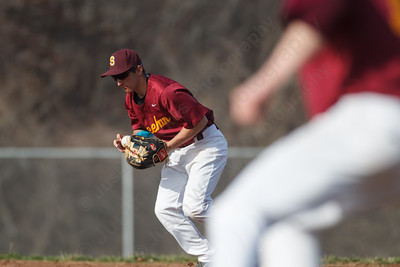 Sheehan's Pete Abate (3) controls a ground ball as Kyle Brennan (12) gets to first Monday at Sheehan High School in Wallingford  Apr. 13, 2015 | Justin Weekes / For the Record-Journal