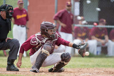 Sheehan's Paul Gozzo (20) reaches for an outside pitch from Turner French (15) Friday at Sheehan High School during the Class M quarter finals in Wallingford  Jun. 5, 2015 | Justin Weekes / For the Record-Journal