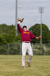 Sheehan's Kyle Brennan (12) tracks down a fly ball from Ledyard's Nicholas Traystman (2) Friday at Sheehan High School during the Class M quarter finals in Wallingford  Jun. 5, 2015 | Justin Weekes / For the Record-Journal