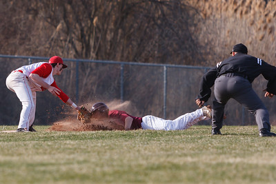 Cheshire's Joe Anderson (10) tags out a sliding Sheehan's Brandon Rentas (31) at third Monday at Sheehan High School in Wallingford  Apr. 13, 2015 | Justin Weekes / For the Record-Journal
