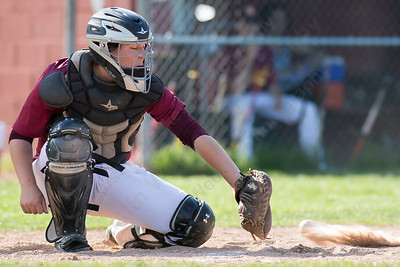 Sheehan's catcher Stephen Carrano traps a low pitch Wednesday at Neubauer Field in Wallingford May. 11, 2016 | Justin Weekes / For the Record-Journal