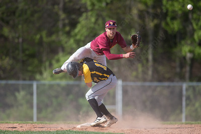 Sheehan's Sal Gozzo get up ended after throw to first by Amity's Adam Hurwitz  ednesday at Neubauer Field in Wallingford May. 11, 2016 | Justin Weekes / For the Record-Journal