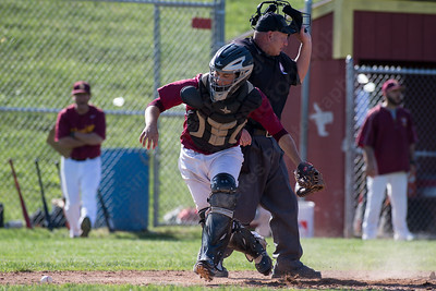 Sheehan's catcher Ryan Kusmit pops up to chase a wild pitch Tuesday at Neubauer Field in Wallingford May. 31, 2016 | Justin Weekes / For the Record-Journal
