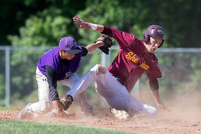 Sheehan's Kyle Brennan gets picked off at second by North Branford's short stop Matt Chamberlain Tuesday at Neubauer Field in Wallingford May. 31, 2016 | Justin Weekes / For the Record-Journal