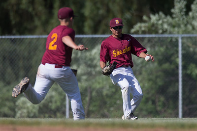 Sheehan's center fielder James Michaud and second baseman Jake Gawlak watch as North Branford's Derek Candelora hit drops for a single Tuesday at Neubauer Field in Wallingford May. 31, 2016 | Justin Weekes / For the Record-Journal