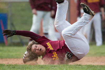 Sheehan's Stephen Carrano tumbles after getting tagged out at home Monday at Sheehan High School in Wallingford Apr. 11, 2016 | Justin Weekes / For the Record-Journal