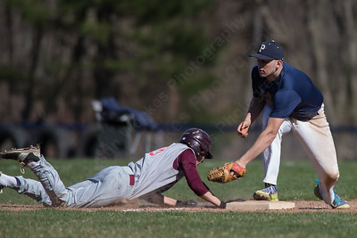 Sheehan's Nolan Cloutier dives back to third as Platt's Jason Sullivan tries to tag Wednesday at Platt High School in Meriden Mar. 30, 2016 | Justin Weekes / For the Record-Journal