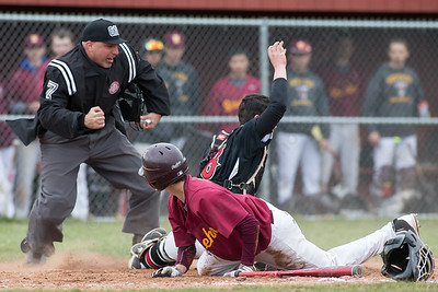 Umpire Joe Barbino makes the call after Cheshire's catchers Brandon Clark holds on for the tag Monday at Sheehan High School in Wallingford Apr. 11, 2016 | Justin Weekes / For the Record-Journal