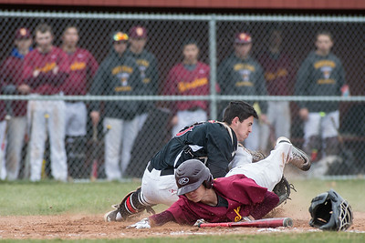 Sheehan's Damon Savenelli reaches for home as Cheshire's catcher Brandon Clark holds on for the out Monday at Sheehan High School in Wallingford Apr. 11, 2016 | Justin Weekes / For the Record-Journal