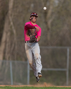 Sheehan's Sal Gozzo makes a leaping throw to first Friday at Pat Wall Field in Wallingford Apr. 22, 2016 | Justin Weekes / For the Record-Journal
