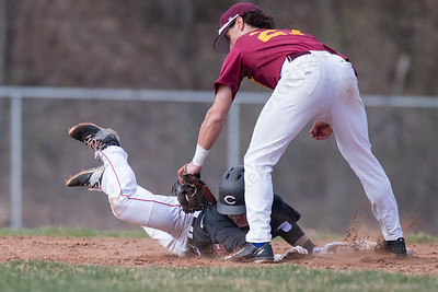 Cheshire's Altrin Kabashi dives back to second base after taking a lead beating the tag from Sheehan's Sal Gozzo Monday at Sheehan High School in Wallingford Apr. 11, 2016 | Justin Weekes / For the Record-Journal