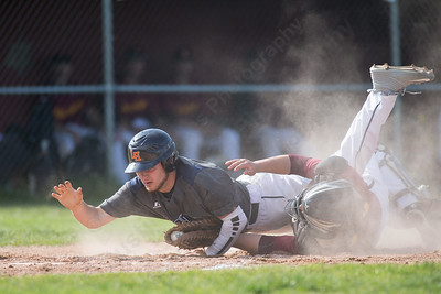 Lyman Hall's Cam Egana dives for home a Sheehan's catcher Stephen Carrano holds onto the ball after contact Monday at Neubauer Field in Wallingford May. 9, 2016 | Justin Weekes / For the Record-Journal