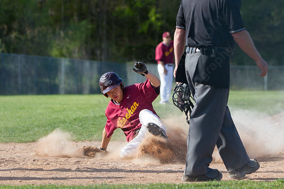 Sheehan's James Michaud slides home for the only score for the Titans Wednesday at Neubauer Field in Wallingford May. 11, 2016 | Justin Weekes / For the Record-Journal