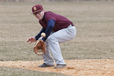 Sheehan's Thurman Deming fields a hits Tuesday during a pre-season scrimmage with Notre Dame West Haven at West Side Field in Wallingford  March 20, 2018 | Justin Weekes / Special to the Record-Journal