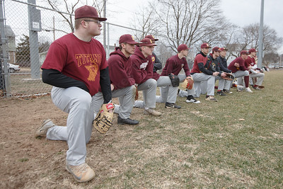 Sheehan watches as Notre Dame takes infield out field practice Tuesday during a pre-season scrimmage with Notre Dame West Haven at West Side Field in Wallingford  March 20, 2018 | Justin Weekes / Special to the Record-Journal