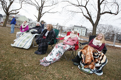 Sheehan parents and students keep warm under blankets in the 30 degree weather Tuesday during a pre-season scrimmage with Notre Dame West Haven at West Side Field in Wallingford  March 20, 2018 | Justin Weekes / Special to the Record-Journal