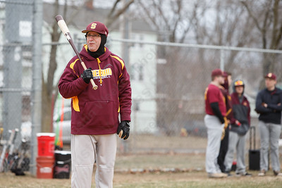 Sheehan's head coach Matt Altieri bundled up in gloves in 30 degree weather delivers infield practice Tuesday during a pre-season scrimmage with Notre Dame West Haven at West Side Field in Wallingford  March 20, 2018 | Justin Weekes / Special to the Record-Journal