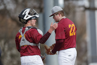Sheehan's Mickey Deming (22) comes in for Kevin Vining Thursday at Westside Field in Wallingford April 5, 2018 | Justin Weekes / Special to the Record-Journal