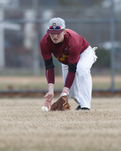 Sheehan's Austin Lee fields a hit in center fro Lyman Hall's Mike Pizzi Thursday at Westside Field in Wallingford April 5, 2018   Justin Weekes / Special to the Record-Journal