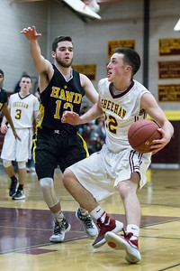 Sheehan's Kyle Brennan (12) drives past Hand's Collin Roth (12) Monday at Sheehan High School in Wallingford Dec. 21, 2015 | Justin Weekes / For the Record-Journal