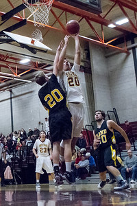 Sheehan's Eli Dyer (20) puts up a shot over Hand's Matt Evans (20) Monday at Sheehan High School in Wallingford Dec. 21, 2015 | Justin Weekes / For the Record-Journal