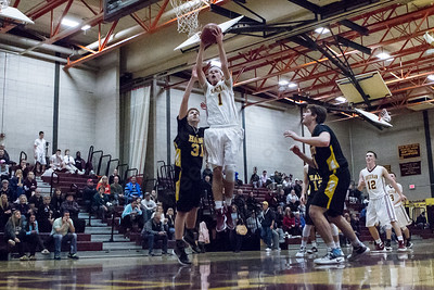 Sheehan's Matt Ottochian (1) brings down an offensive rebound Monday at Sheehan High School in Wallingford Dec. 21, 2015 | Justin Weekes / For the Record-Journal