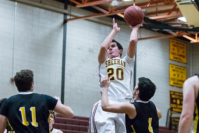 Sheehan's Eli Dyer (20) puts up a shot in the lane Monday at Sheehan High School in Wallingford Dec. 21, 2015 | Justin Weekes / For the Record-Journal