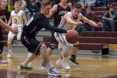 Sheehan's Garrett Molampy and Cheshire's Will Graikoski reach for a loose ball Tuesday at Sheehan High School in Wallingford January 16, 2018 | Justin Weekes / Special to the Record-Journal