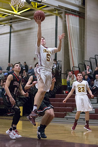 Sheehan's Austin Lee puts in a layup Tuesday at Sheehan High School in Wallingford January 16, 2018 | Justin Weekes / Special to the Record-Journal