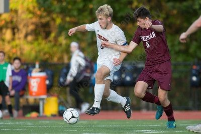 Lyman Hall's Jack Gaynor works past Sheehan's Tyler Jasinski Tuesday at Lyman Hall High School in Wallingford October 3, 2017 | Justin Weekes / For the Record-Journal