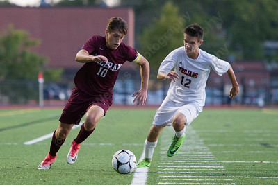 Sheehan's Jason Umbehr gets past Lyman Hall's Declan Turbett Tuesday at Lyman Hall High School in Wallingford October 3, 2017 | Justin Weekes / For the Record-Journal