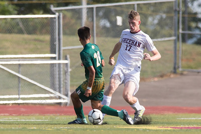 Sheehan's Camden Wallace gets past Hamden's Harrison Cozzubbo Mejia Monday at Riccitelli Field on the Sheehan High School Campus in Wallingford September 11, 2017 | Justin Weekes / For the Record-Journal