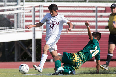 Hamden's Harrison Cozzubbo Mejia challenges Sheehan's Alberto Avila  Monday at Riccitelli Field on the Sheehan High School Campus in Wallingford September 11, 2017 | Justin Weekes / For the Record-Journal