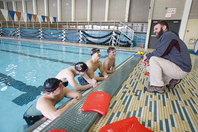 Sheehan's head swimming coach Keith Cargan talks with team members during a final practice before the CIAC State Open Friday at Sheehan High School Natatorium in Wallingford March 16, 2018 | Justin Weekes / Special to the Record-Journal