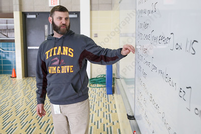 Sheehan's swimming head coach Keith Cargan reviews the days workout in preparation for the CIAC State Open Friday at Sheehan High School Natatorium in Wallingford March 16, 2018 | Justin Weekes / Special to the Record-Journal