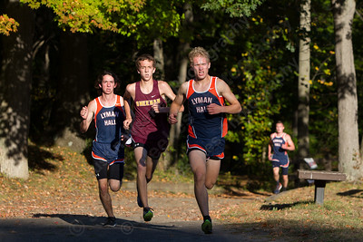 Lyman Hall's Alexandre Fishbein-Ouimette leads Sheehan's Stephen Fengler and Lyman Hall's Brian Oliveira Thursday at Wharton Brook State Park in North Haven October 12, 2017 | Justin Weekes / For the Record-Journal