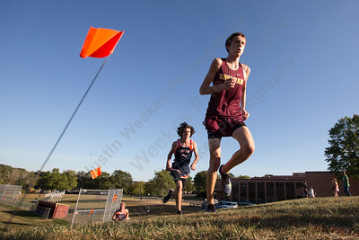 Sheehan's Stephen Fengler leads Lyman Hall's Brian Oliveira on the up hill Tuesday during the Neubauer Invitational at Sheehan High School in Wallingford October 3, 2017 | Justin Weekes / For the Record-Journal