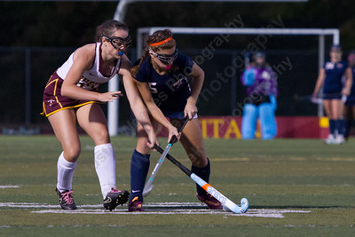 Lyman Hall's Alivia Celentano is challenged by Sheehan's Stephanie Phoenix Wednesday at Riccitelli Field on the campus of Sheehan High School in Wallingford October 4, 2017 | Justin Weekes / For the Record-Journal