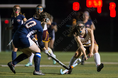 Sheehan's Stephanie Phoenix gets past Lyman Hall's Michaela Keating Wednesday at Riccitelli Field on the campus of Sheehan High School in Wallingford October 4, 2017 | Justin Weekes / For the Record-Journal