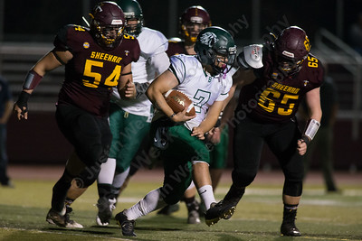Sheehan's Luke Willette (65) tracks down Bassick's Dennis Ferrer Friday at Riccitelli Field on the campus of Sheehan High School in Wallingford November 3, 2017 | Justin Weekes / For the Record-Journal