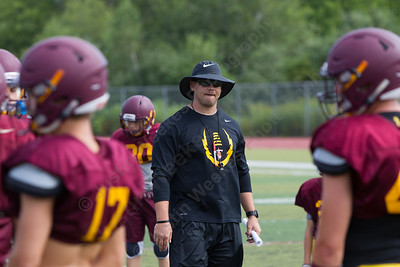 Sheehan's head coach John Ferrazzi watches over his defense during practice Wednesday at Riccitelli Field in Wallingford Aug. 23, 2017 | Justin Weekes / For the Record-Journal
