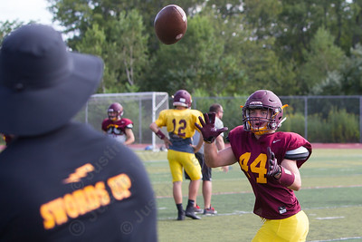 Sheehan's Will Terzi catches a pass from coach John Ferrazzi Wednesday at Riccitelli Field in Wallingford Aug. 23, 2017 | Justin Weekes / For the Record-Journal