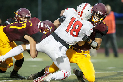 Sheehan's Jake Smith brings down Fairfield Prep's Connor Boyle Friday at Riccitelli Field on the campus of Sheehan High School in Wallingford September 28, 2018 | Justin Weekes / Special to the Record-Journal