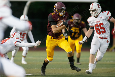 Sheehan's Jake Smith finds running space for a first down Friday at Riccitelli Field on the campus of Sheehan High School in Wallingford September 28, 2018   Justin Weekes / Special to the Record-Journal
