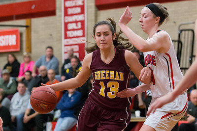Sheehan's Olivia Robles gets past Cheshire's Ciara Haensel Wednesday at Cheshire High School in Cheshire Feb. 3, 2016 | Justin Weekes / For the Record-Journal