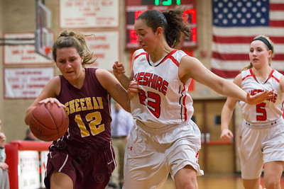 Sheehan's Cassie Strickland tries to get past Cheshire's Nillie Burton guards Wednesday at Cheshire High School in Cheshire Feb. 3, 2016 | Justin Weekes / For the Record-Journal