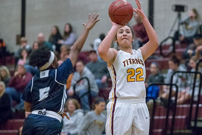 Sheehan's Olivia Robles hits a three point shot Friday at Sheehan High School in Wallingford December 29, 2017 | Justin Weekes / Special to the Record-Journal