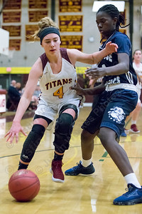 Sheehan's Mackenzie Hemstock drives on Hillhouse's Fatihah Singleton Friday at Sheehan High School in Wallingford December 29, 2017 | Justin Weekes / Special to the Record-Journal