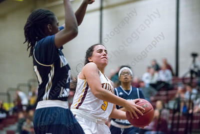 Sheehan's Alexia Ocasio drives to the basket Friday at Sheehan High School in Wallingford December 29, 2017 | Justin Weekes / Special to the Record-Journal