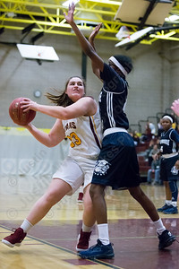 Sheehan's Carolyn Biel posts up on Hillhouse's Kiana Brown Friday at Sheehan High School in Wallingford December 29, 2017 | Justin Weekes / Special to the Record-Journal
